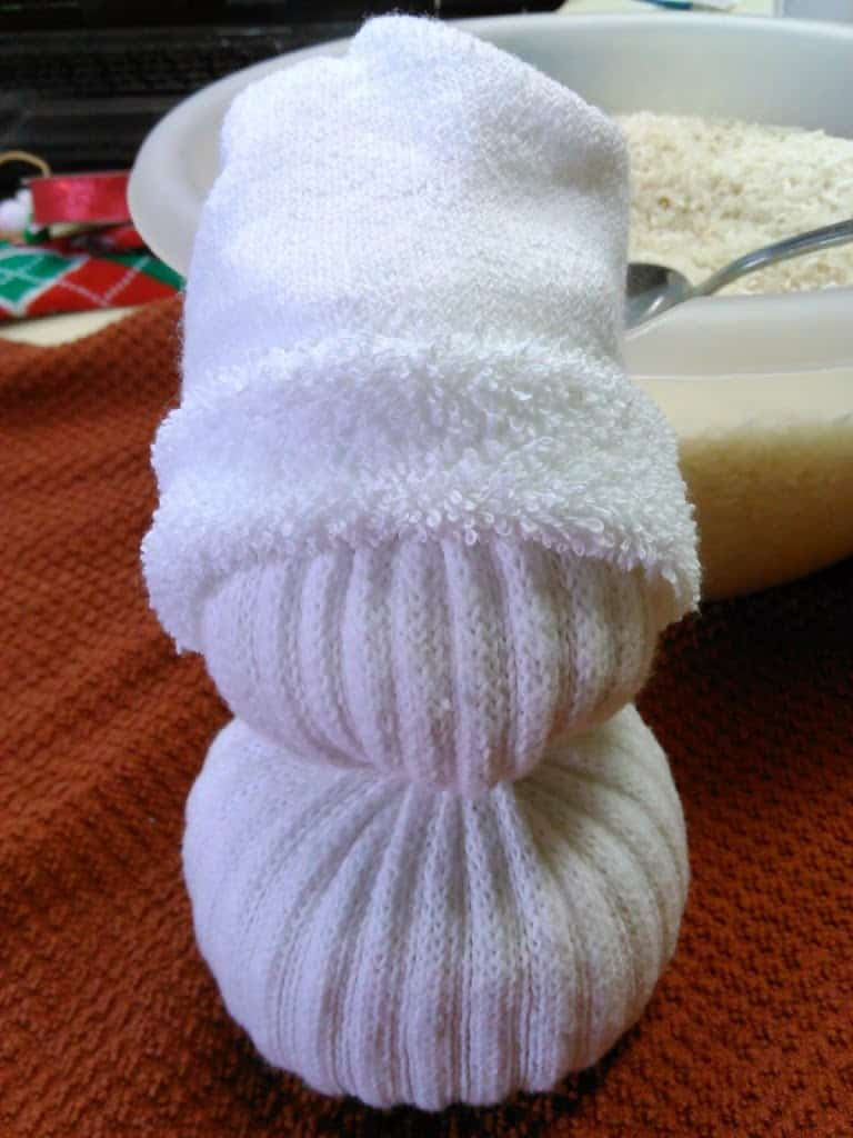 Place the bottom part of the sock onto his head to for a stocking cap