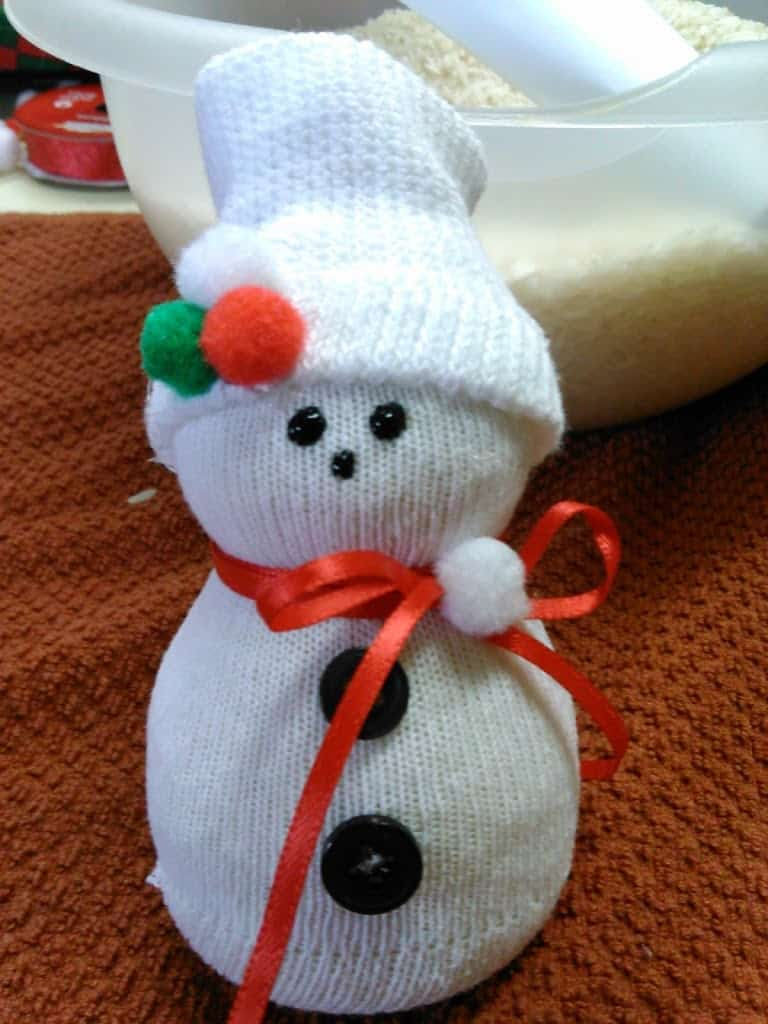 Finished product snowman 1 was made using a mans crew sock snowman