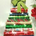 Gift Wrap DIY Christmas Tree Wall Canvas. If you are looking for a fun Christmas Project that is inexpensive to make and absolutely adorable, this one is it! Check it out! | DailyDIYLife.com