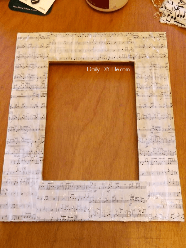 an easy and fun project using old sheet music make this fun diy photo frame - Music Picture Frame