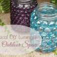 Whimsical DIY Glass Stone Luminaries. Perfect addition to any Outdoor Space. Elegant enough to even be used as a centerpiece for a Summer Wedding. DailyDIYLife.com