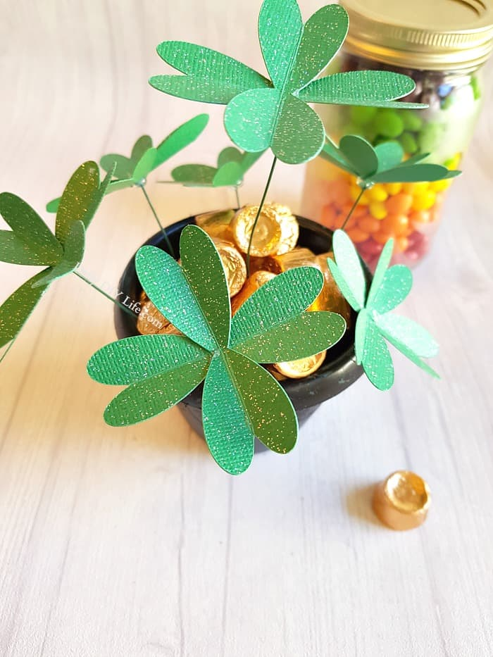 Looking for an Easy Cricut Craft for St. Patricks Day? These adorable DIY Paper Four Leaf Clovers will add just the right touch to your decor or next craft project. A simple project for any Cricut machine. #CricutMade #EasyCricutCraft #StPatricksDayCraft #DIYPaperCrafts