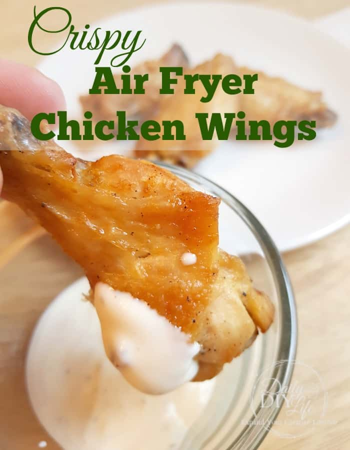 This recipe for Crispy Air Fryer Chicken Wings is just as good as your favorite restaurant style wings, without all the added fat and calories. Serve them piled high and tossed in your favorite wing sauce. You can't go wrong with chicken wings! #Recipe #AirFryer #AirFryerRecipe #ChickenWings #AirFryerChickenWings